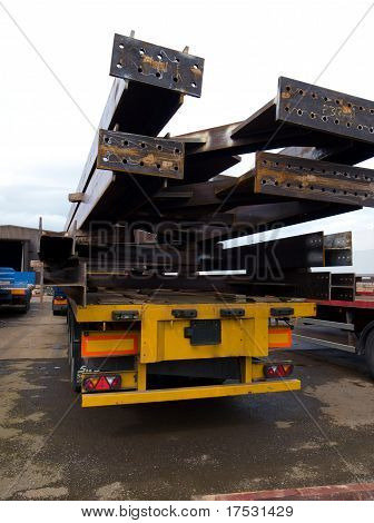 heavy steel beams on trailer