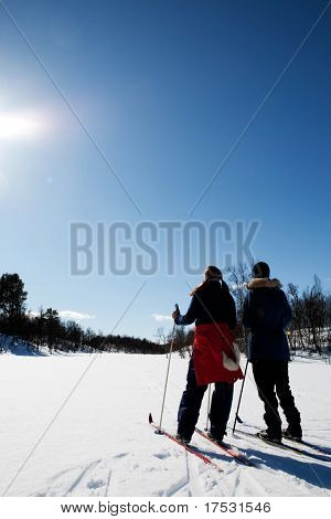 Two women in a winter landscape cross country skiing