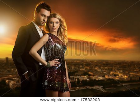 Attractive young couple on the city background