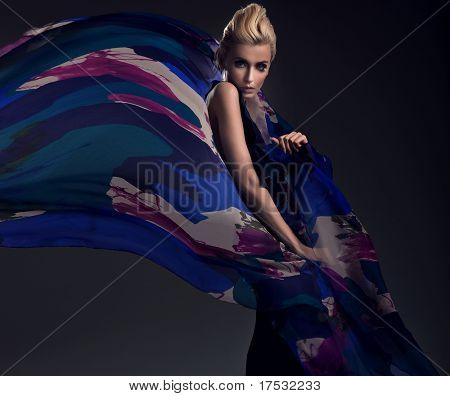 Romantic photo of a blonde wearing colorful dress