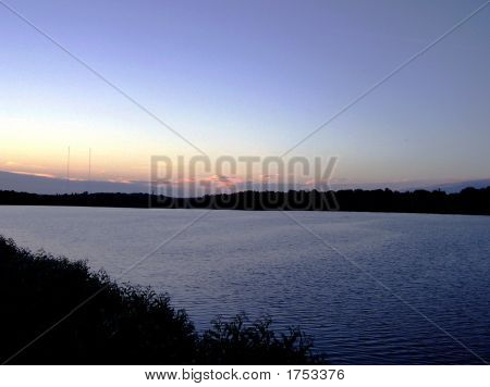 Sunset Horizon Over a Farm Pond