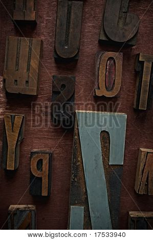 Vintage letters on wooden background