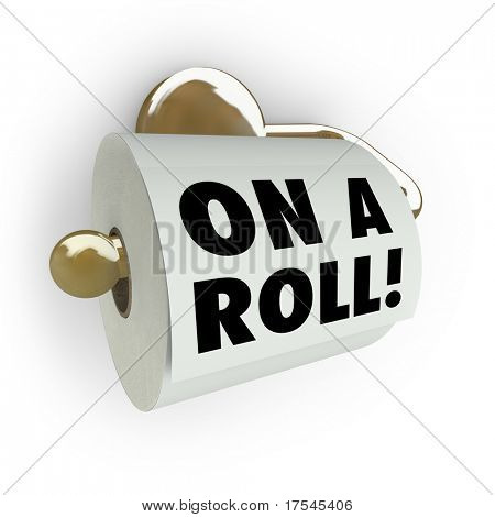A toilet paper roll and dispenser with the words On a Roll, symbolizing forward momentum and success in working toward a goal