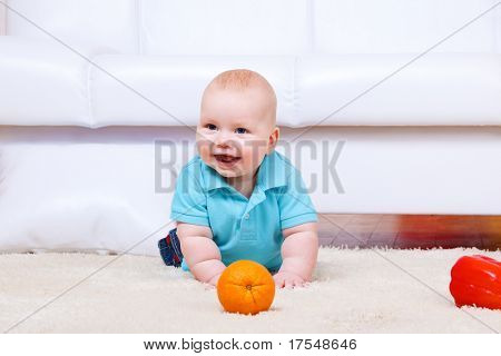 Cheerful kid crawling on the floor