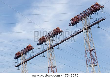 Power poles on blue sky background
