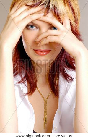 "close up portrait of young woman playing ""hide and seek"""