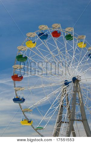Tall Ferris wheel against sky background