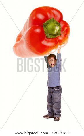 Little boy holding giant red pepper