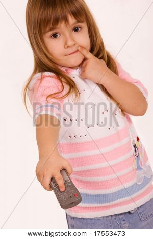 Little girl holding remote control pad