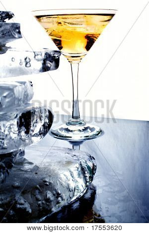 Wineglass with yellow liquor an a pile of clear ice
