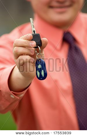 Businessman hand holding car keys
