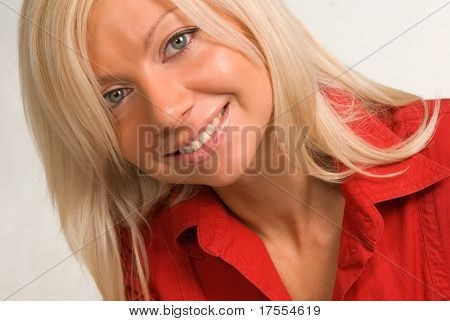 Portrait of sensual young blond with beautiful long hair