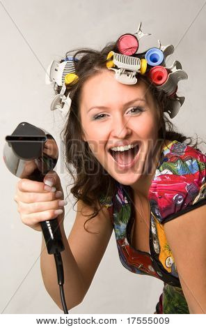 Young attractive woman with hairdryer