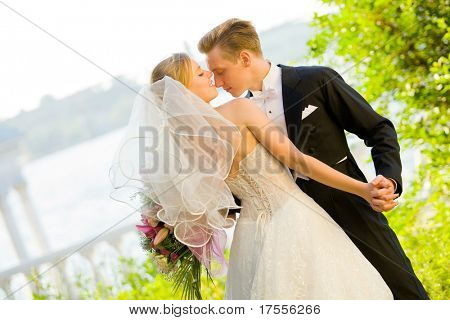 Colorful wedding shot of bride and groom dancing