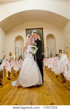Beautiful bride and groom on wedding ceremony in church