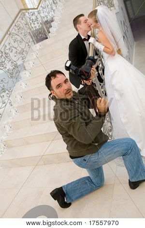 Wedding photographer taking a shot of bride and groom
