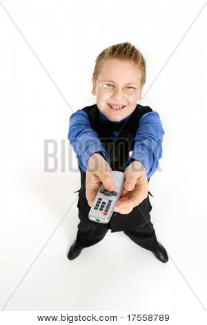 Funny looking boy with TV remote control