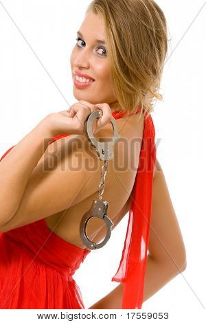 Hot natural blonde with handcuffs isolated on white