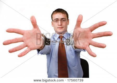 Businessman with handcuffs over hands, isolated