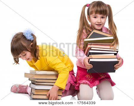 Two pretty little girls holding stack of books