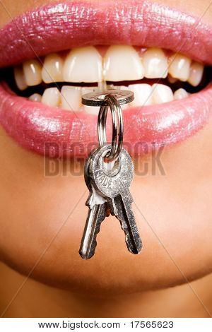 Closeup of woman lips with keys