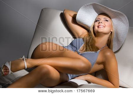 Gorgeous sexy model in  light blue night wear and wide hat