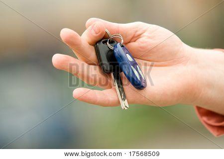 Man's hand holding car keys