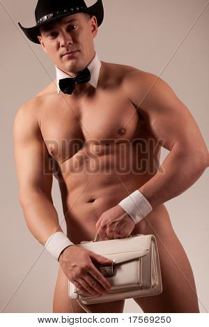 Muscular male stripper with woman purse