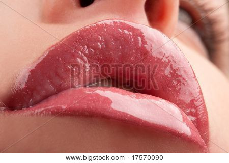 Perfect shiny woman's lips closeup