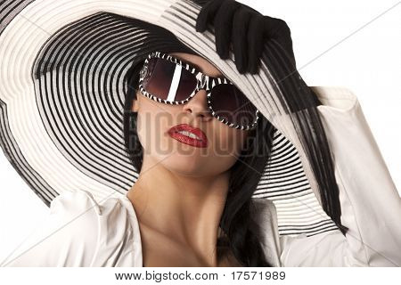 Beautiful model in striped hat and sunglasses on the white background