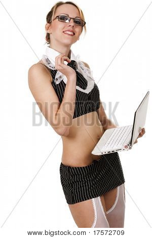 Beautiful sexy secretary wearing very short skirt pretending to work on laptop