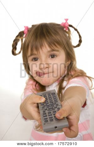Joyful little girl holding tv remote control