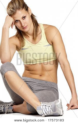 Cute caucasian athletic model over white background