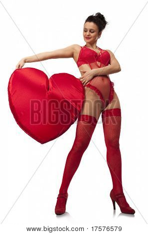 Young woman in red lingerie holding big Heart over white