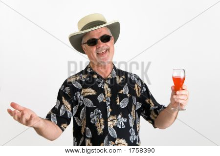 Man Drinking A Tropical Drink In A Hawaiian Shirt
