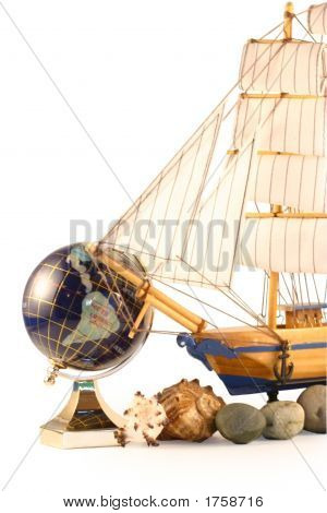 Sailing Vessel, Sea Shells And The Globe Isolated On White