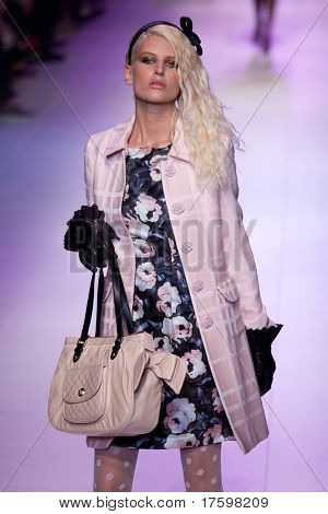 MELBOURNE - MARCH 19: A model showcases designs by Alannah Hill in the 2011 L'Oreal Melbourne Fashion Festival at Central Pier, Docklands on March 19, 2011 in Melbourne, Australia