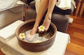 Female feet treatment in spa salon poster