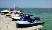 picture of jet-ski  - Jet skis and a speedboat tied up in a marina - JPG