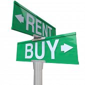 A green two-way street sign pointing to Buy and Rent, symbolizing being at a crossroads and deciding