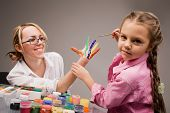 stock photo of finger-painting  - Little girl playing with mom - JPG