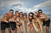 foto of beach party  - Joyful team of friends having fun at the beach - JPG