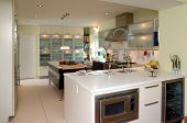 Modern Kitchen With White Counter Top And Stainless Steel Appliances