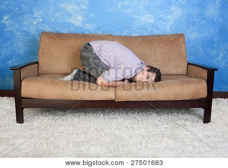 Angry Young Man On Sofa