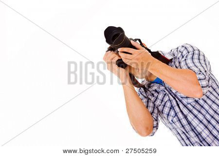 Photographer in action with camera, isolated on white