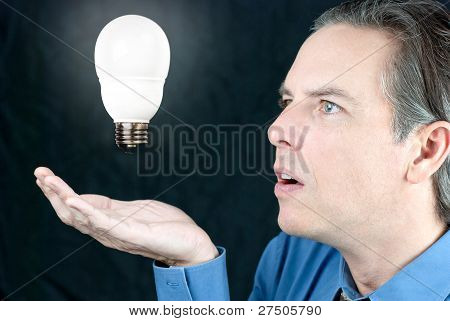 Businessman Awestruck By Lightbulb