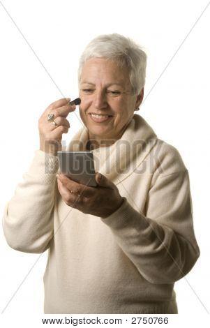 Mature Woman Applying Blusher
