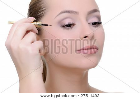 woman applying make-up