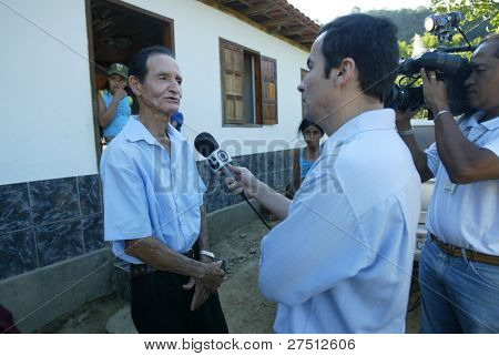 GONZAGA, BRAZIL - JULY 26: Matozinhos Otoni da Silva (L) speaks outside his home on July 26, 2005 in Gonzaga, Brazil. His son, Jean Charles de Menezes, 27-years-old, was killed by undercover UK police.