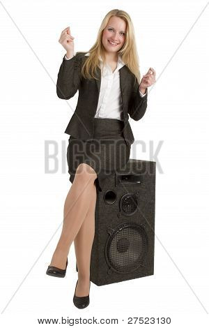 Happy Businesswoman Sitting On Speakers